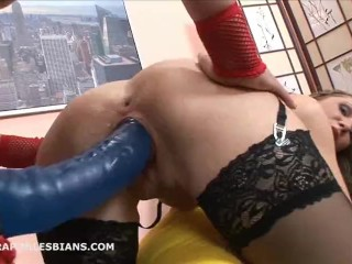 Rita is bent over and fucked with a huge strapon dildo