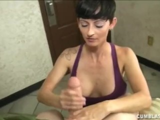 Naughty nurse jerks a big dick