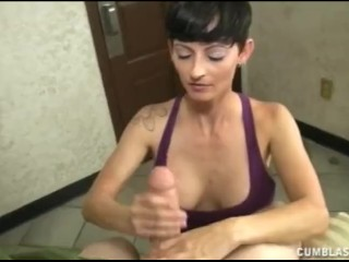 Naughty nurse jerks a big dick