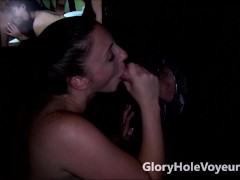 Melanie Hicks Sucks Large Cock in Gloryhole Booth