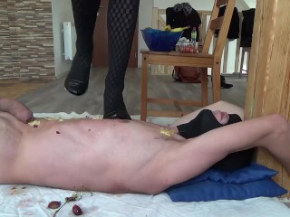 Fruit crush on slaves body with high heels