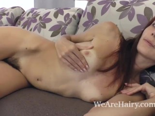 Scarlett Nika strips naked and shows body on couch