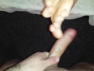 Footjob and cock rolling between feet with cumshot