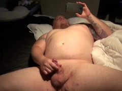 chubby tattooed guy with pierced dick jacks off to porn