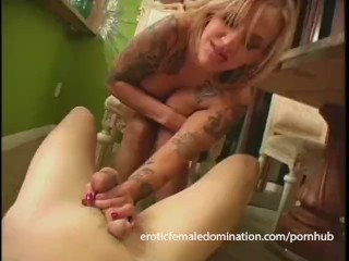Tattooed blonde slut enjoys kicking a loser right in the nuts