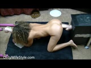 Sexy brunette fucks huge dildo on her knees
