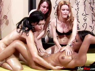 Shemale girlfriends massage each others asses and cocks