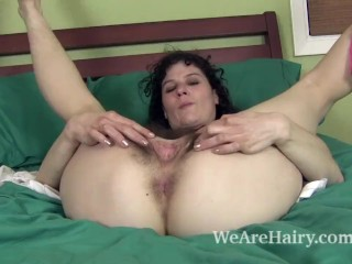 Sunshine models her hairy body and masturbates