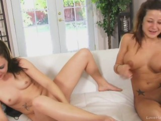 Stunning lesbian brunettes toying on the couch