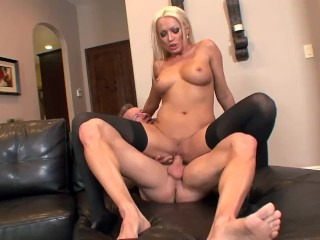 Blonde milf Diana Doll fucked on a couch in black thigh high stockings