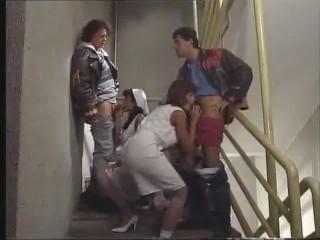 Anita Blonde and Anita dark blowjob on stairs