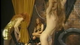 Crossdresser enjoys a very painful flogging session in the dungeon