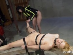 Master and Mistress strap their new slave down on the table for fun