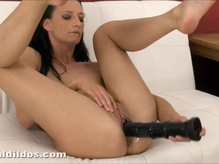 Brunette babe slamming a big black brutal dildo deep in her pussy in HD