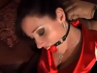 Christina Carter in a red satin blouse