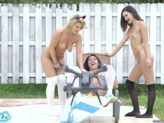 lesbian teen threesome play tug a war with a drone and their college pussy