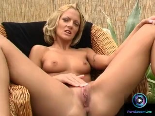 Short haired blonde Christel dildoing naked at the garden