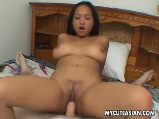 Busty and beautiful brunette getting her wet pussy hammered