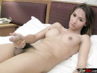 Ladyboy hottie with perfect big boobs jerks big long cock