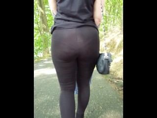 She walks down the street in see through leggings