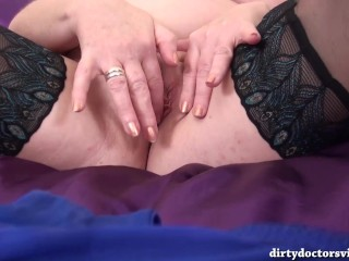 Hot Mature Trisha Playing with Her Glass Dildo before Pissing On The Bed