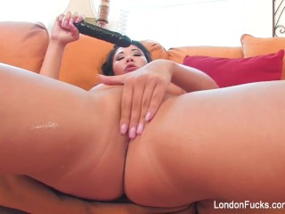 London enjoys some hot playtime with a black dildo