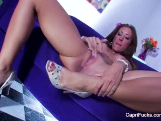 Super sexy Capri stuffs her pussy with a glass toy