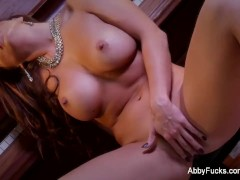 Brunette babe Abigail Mac rubs her pussy