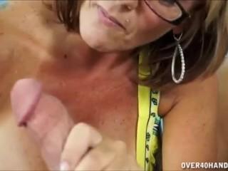 Horny milf strokes a fat cock