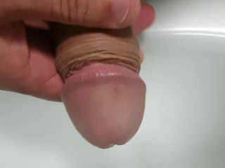 Pissing into my foreskin before massaging my glans to orgasm