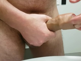 Guy finger fucking his cock