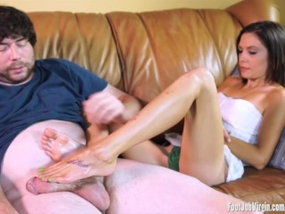 Hot girl gives a footjob while masturbating