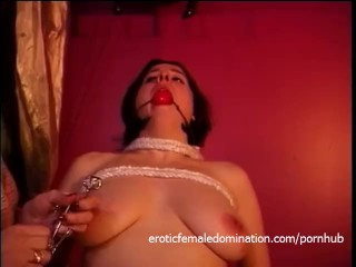 Busty raven-haired harlot enjoys letting a redhead slag spank her hard