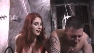 Stunning latex-clad redhead domina has some fun with her man  kink whipping latex bdsm spanking dominatrix babe redhead femdom old dungeon