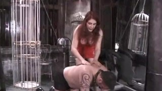 Stunning latex-clad redhead domina has some fun with her man  spanking dominatrix babe bdsm big-tits redhead femdom old dungeon sex-toys kink latex whipping nipple-pinching