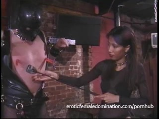 Kinky stud in a mask enjoys being spanked by an Asian harlot