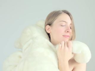 Hot naked blonde cuddling her teddy bear