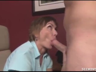 Mature lady sucks the naked guy's cock
