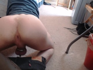 bottom fag has fun with chastity cage