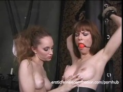 Bound and gagged brunette cutie gets whipped by a skinny temptress