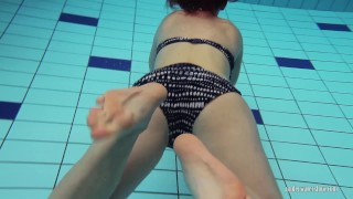 Preview 2 of Redheaded Katrin stripping underwater
