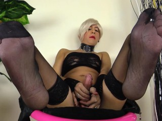 blonde shemale pumps her cock in black stockings