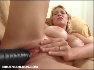 Busty blonde punishes her pink pussy with thick dildo