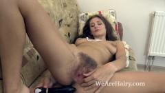 Shivali masturbates with her new black vibrator
