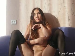 Tantalizing brunette in stockings reveals her sweet booty
