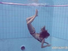Lucy takes off bikini in the pool