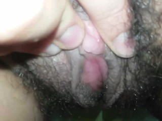 Close up hairy pussy pee and swollen clit play