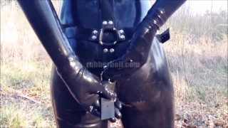 Hot girlfriend pissing in full black latex catsuit  kink rubber doll latex piss rubber fetish latex fetish rubber catsuit latex femdom rubber piss latex catsuit catsuit pissing in public