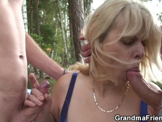 Busty blonde granny double penetration on beach