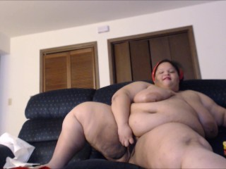 Fat ebony SSBBW lubes up her tits and plays with a glass toy